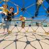 Family on Playground Geodesic Dome