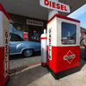 An old gas station with Borgward cars
