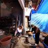 Father and son blacksmiths in Bac Ha fair, Vietnam (Cha con bác thợ rèn ở chợ phiên Bắc Hà)
