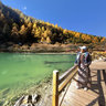 The scenery of Sichuan Daocheng Yading 13——Watch Xiannairi snow peak in Chonggusi Pearl Sea